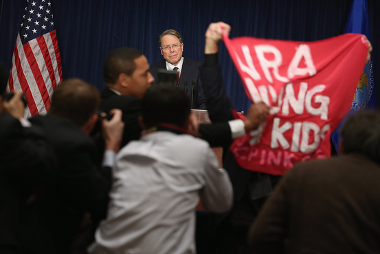 Wayne LaPierre is interrupted by a protester at his post-Newtown press conference